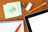 Tablet pc and office supply — Stock Photo