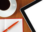 Tablet pc, notepad, pen, money and cup of coffee — Stock Photo