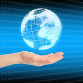Hand with globe — Stock Photo