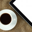 Touch screen device and cup of coffee — Stock Photo