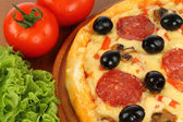 Salami pizza with vegetables — Stok fotoğraf
