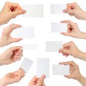 Manos sostienen tarjetas — Foto de Stock