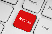 Red warning button — Stock Photo