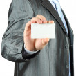 Businessman with white card — Stockfoto