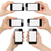 Hands holding smart phones — Stockfoto