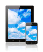 Tablet pc and smart phone with blue sky — Stock Photo