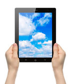 Woman hands holding tablet PC with sky — Stock Photo