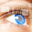 Woman blue eye looking on digital virtual screen — Stock Photo