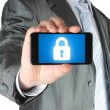 Businessman holds smart phone with closed lock — Stockfoto