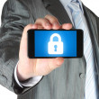 Businessman holds smart phone with closed lock — Stock Photo #31221763