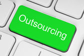 Green outsourcing button — Stok fotoğraf