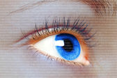 Woman blue eye looking on a digital virtual screen — Stock Photo
