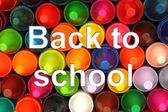 Color pencils background with back to school words — Stock Photo