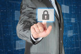 Businessman pushing virtual security button — Stock Photo