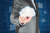 Businessman pushes cloud on dark digital background — Stock Photo