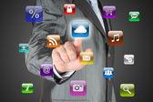 Man pushes virtual icon — Stockfoto