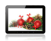 Tablet PC with Christmas decoration — Stockfoto