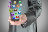 Man uses smart phone with icons — Stock Photo