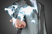 Businessman uses virtual map — Stock fotografie