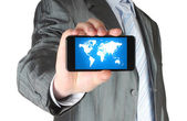 Man holds smart phone with map — Stock Photo