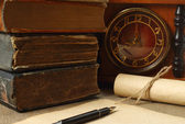 Retro composition with books, clock, paper and pen — Stock Photo