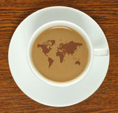 Coffee cup with map — Stock Photo