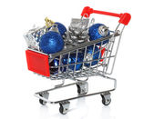 Shopping cart with Christmas gifts — Stockfoto