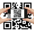 Stock Photo: Hands hold smart phone with QR code