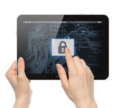Hand pushing virtual security button on digital background of tablet PC — Stok fotoğraf