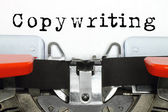 Part of typing machine with typed copywriting word — Stock Photo