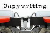 Część wpisując maszyny z copywriting wpisane słowo — Zdjęcie stockowe