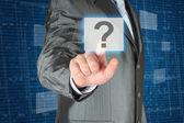 Businessman pushing virtual question button — Stock Photo