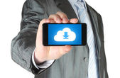 Man holds smart phone with cloud download concept — Stock Photo