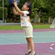 Exercising little cute girl with basketball - Stock Photo