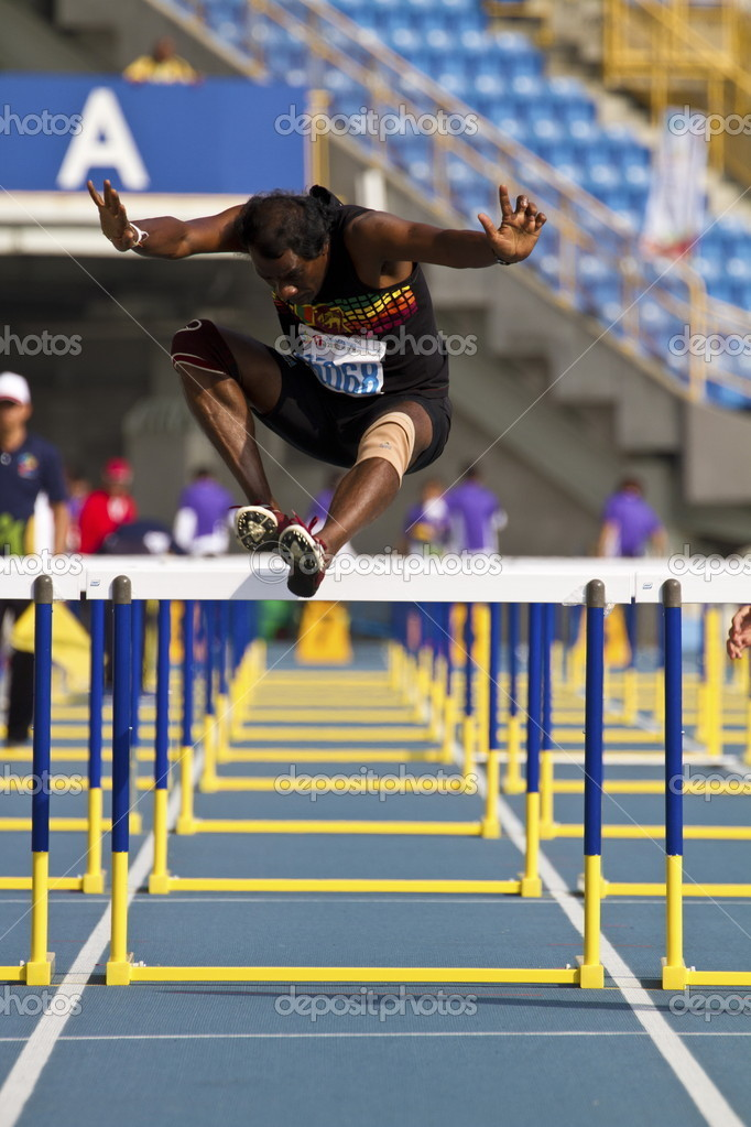 TAIPEI,TAIWAN -November 4,2012:100m man hurdles athlete in 17th Asia Master Athletics Championships in Taipei stadium on November 4,2012 in Taipei,Taiwan — Stock Photo #15354521