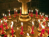 Group of burning religion candles — Stock Photo