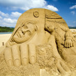Through the eyes of babes sand sculpture — Stock Photo
