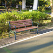 Stock Photo: Wooden park bench