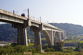 Train crossing a viaduct — Stock Photo