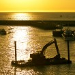Excavator machine construct on seunder twilight — Stock Photo #38123951