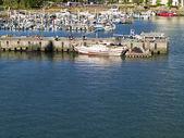 Fishing boats at wharf — Stock Photo