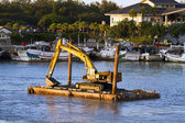 Excavator machine construct on sea — Stock Photo