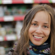 Royalty-Free Stock Photo: Young happy girl in a supermarket