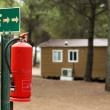 Fire extinguisher and mobile homes — Stock Photo