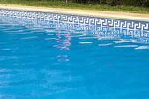 Swimming pool and pillar — Stock Photo