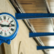 Antique external clock on railway station — Stockfoto #13526879