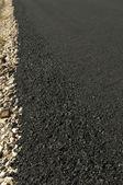 Newly built asphalt road — Stock Photo