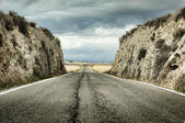 Old dramatic asphalt road — Stock Photo