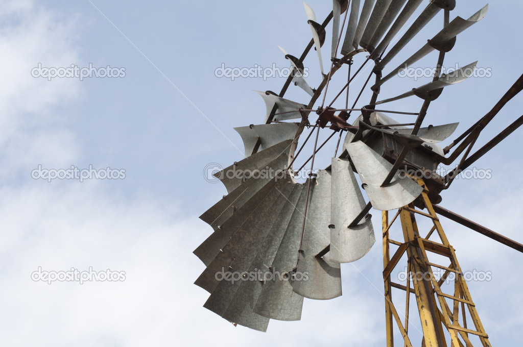 Old windmill over blue sky — Stock Photo #13804552