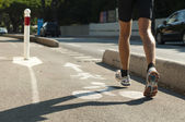 Human feets in sportshoes running — Stock Photo